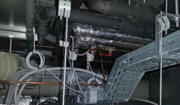 Bekabeling boven systeemplafond | DGMR